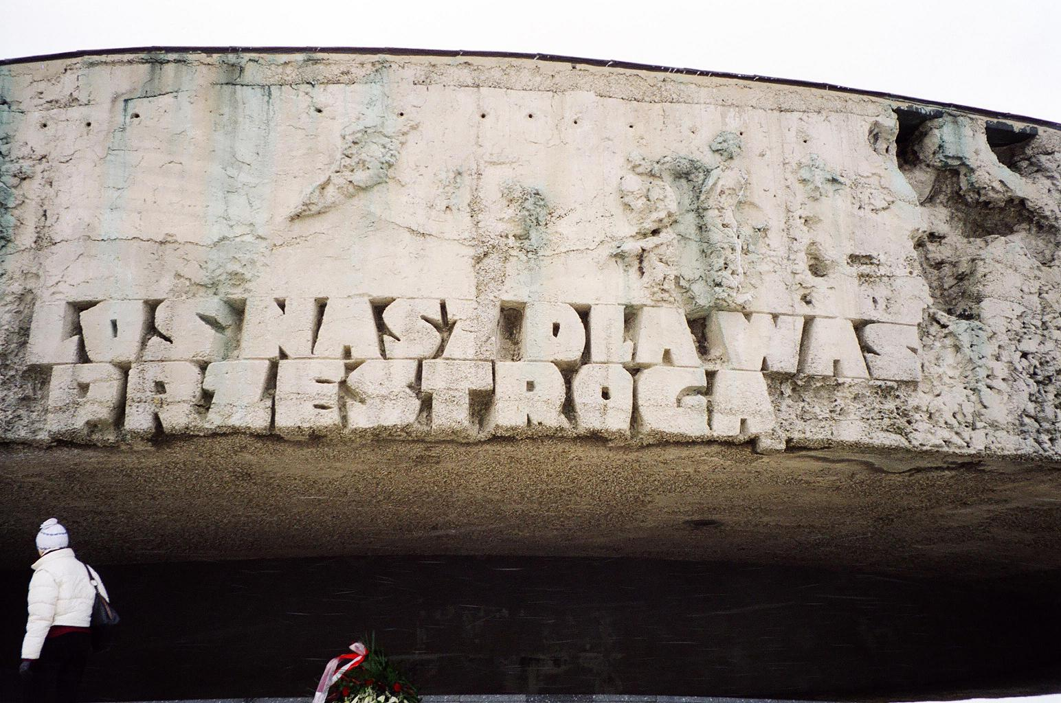 "On the side, the phrase ""May our fate be a warning to you"" – Majdanek, Poland"