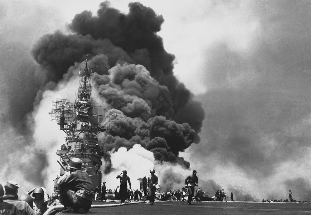 Flames on the deck of USS Bunker Hill, after a double kamikaze strike within 30 seconds. 346 died – 11 May 1945 (photo)