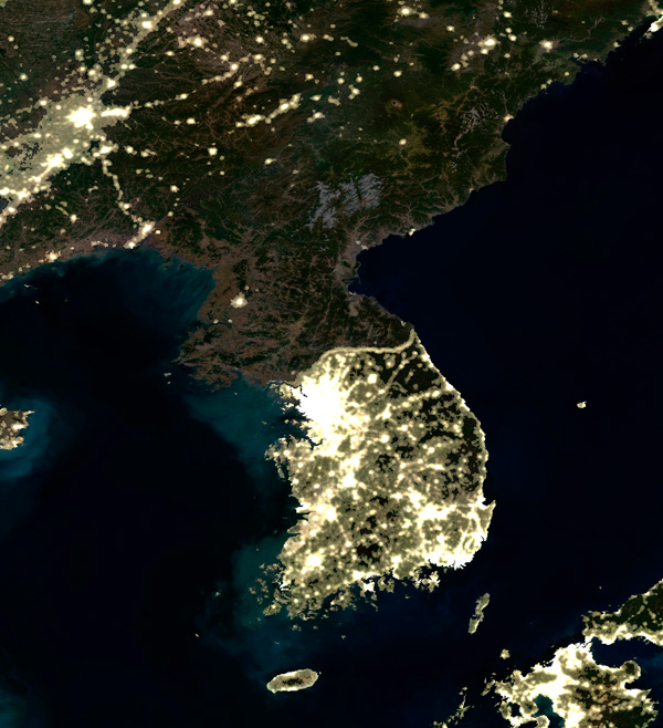 The decline and under-development is obvious in satellite images of night-time North Korea, where the entire country is in darkness (photo)