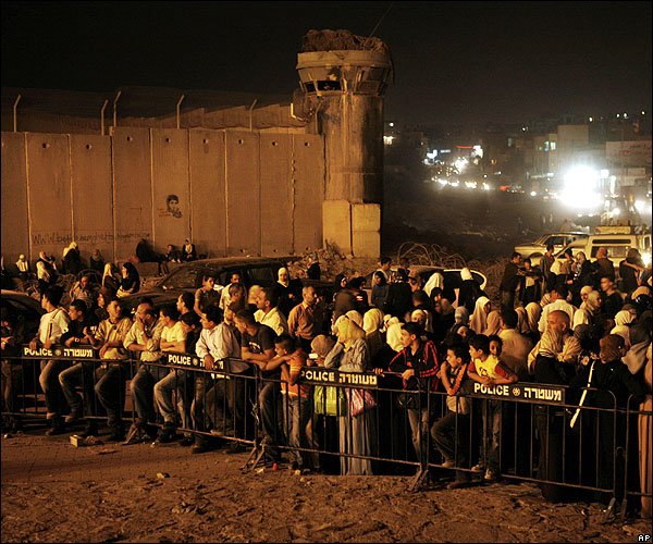 "The ""victims' victims"" as Said characterizes his fellow countrymen, in waiting lines at an Israeli checkpoint (photo)"