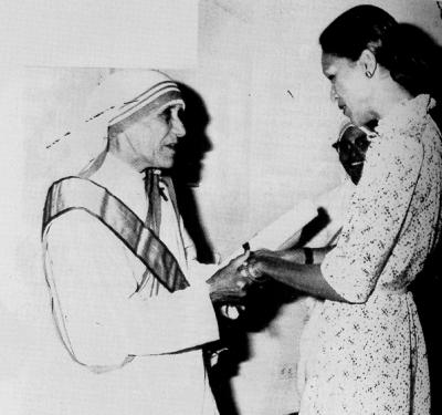 "Mother Teresa with Michele Duvalier, wife of the ruthless dictator ""Baby Doc"" (source)"