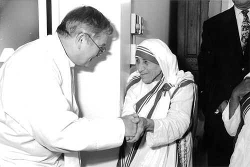 Mother Teresa with Father Donald McGuire, a convicted child molester (source)