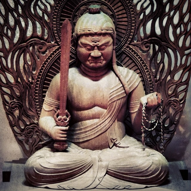 This sword will tear through the illusion of the self and the throats of Buddha's enemies (Statue of the deity Acala, who represents balance and a steadfast mind) (photo)