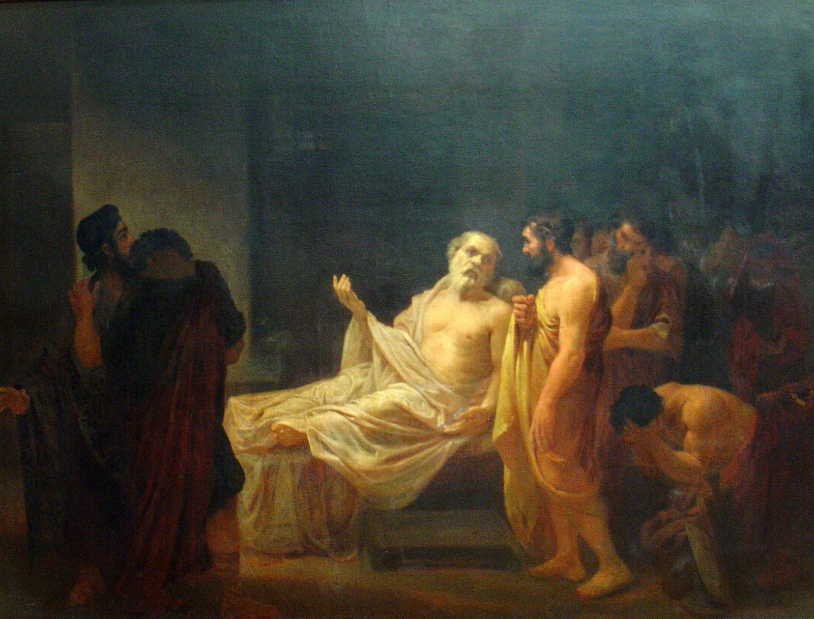 How does Socrates explain the afterlife? Is he afraid of death?